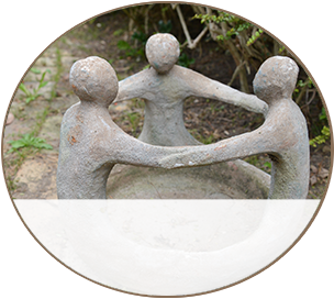 Clay Statue of Three Puppets Holding Hands
